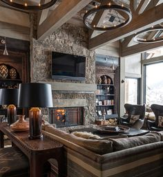 Viking Views-a ski chalet located in the Yellowstone Club, Big Sky, MT.  This modern mountain home makes thoughts of winter warmer, with its neutral plaster walls, washed timber beams, and the upscale upholstery juxtaposed with Native American textiles.   This sleek ski lodge with a tribal twist is simple amazing!