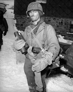 An American soldier back from the front lines near the town of Murrigen, Belgium during the Battle of the Bulge - 1945