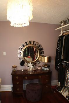 Cute small vanity. Love the elegant wall color