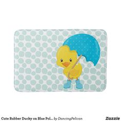 Cute Rubber Ducky on Blue Polka Dots Bath Mat - A cute rubber duck with umbrella and galoshes against a pattern of blue chunky polka dots makes a whimsical addition to a bathroom. Suitable for children and adults! Matching shower curtain available in this motif. Sold at DancingPelican on Zazzle.