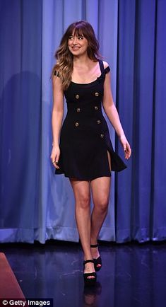 Johnson showed off her curves in a mini Versace dress