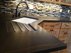 Cool Corner Kitchen Sink Plus Black Faucet Combined With Concrete Countertop Fit Glassy Tile Backsplash