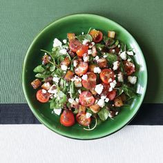 Wilted Arugula Salad with Crisp Potatoes, Feta & Warm Black Olive Vinaigrette