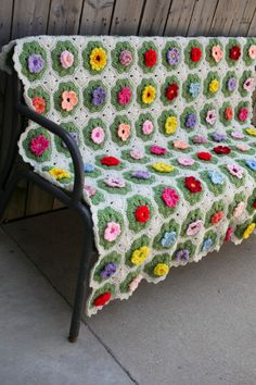 A Field of Flowers Afghan - Crochet your own garden using this vibrant pattern that features 12 different types of crocheted flowers. This eye-catching throw is truly a work of art. From I Like Crochet's June 2014 issue