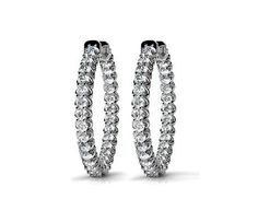 Glam up your week with these large diamond hoop earrings in 14k white gold, featuring 37 round cut diamonds in the inside and outside of each hoop!   http://www.brilliance.com/earrings/large-diamond-hoop-u-prong-earrings-white-gold