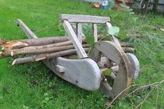 A medieval wheelbarrow.  Cost about 25 dollars.  It's been used & abused for five solid years now. I blogged it here: http://garb4guys.blogspot.com/p/woodworks.html