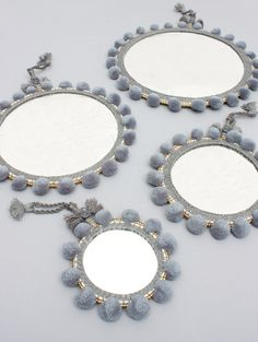 **New to LoveBohemians!!**  The Pom Pom Mirrors in contemporary Grey are handcrafted by our team in India using age-old skills and techniques. With 100% wool pom poms and embroidery surrounding a double sided mirror, these mirrors make a practical and eye-catching addition to the bathroom, bedroom or living areas. Available in 4 contemporary colours and 4 sizes, group different sizes and colours of Pom Pom Mirrors together for a bold and vibrant statement, or hang separately to bring small…