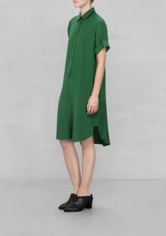 & OTHER STORIES Sleek viscose shapes this short-sleeved shirtdress detailed with rolled sleeves and a hang loop at front.
