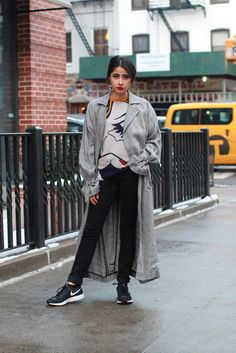 """4 New York Bloggers, 1 Full Month Of Outfit Inspiration #refinery29  http://www.refinery29.com/march-2015-outfit-ideas#slide-20  Saturday""""I love how cool a really long coat looks with sneakers.""""What She's Wearing: Topshop coat, 3.1 Phillip Lim pullover, Proenza Schouler jeans, Nike sneakers, and vintage Yves Saint Laurent earrings."""