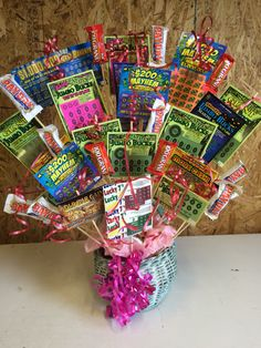 Lottery ticket gift basket I made for my mom's 64th birthday!! It has 64 dollars worth of lottery tickets.