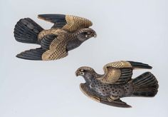 Pair of menuki in the form of two hawks      Japanese, Edo period, Early 19th century.     Ishiguro Kanemoto, Japanese, about 1825.