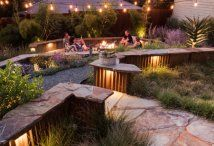 Wish you were here relaxing in the easy glow of the firepit & lighting at dusk.