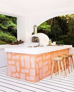 "Domino on Instagram: ""While you think the pink and orange-tiled island in this outdoor kitchen would be the star of the show, the family says it's the pizza…"""