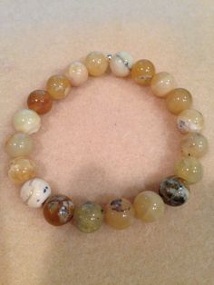 Yellow Opal 10mm Round Bead Stretch Bracelet with Sterling Silver Accent https://www.etsy.com/listing/468532857/yellow-opal-10mm-round-bead-stretch