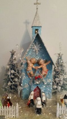 Blue glitter church with cherubs
