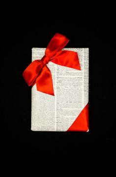 Wrapping gifts in a photocopied page from the dictionary