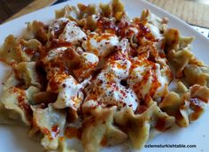 Manti; delicious Turkish dumplings with spiced ground meat, served with garlic yoghurt and spices infused olive oil.