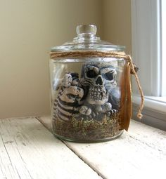 EASY Halloween DIY! Or buy one on Etsy for $35 - I made one last year with an Anchor Hocking jar from Amazon and moss and skeleton parts from Oriental Trading...will post pics. May be wiser to just buy on Etsy unless you were making several.