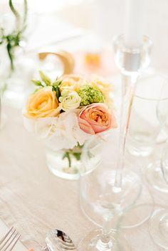 Simple + elegant wedding centerpiece idea - floral centerpieces with pink + orange roses in glass vessels {Elias Kordelakos Photography}