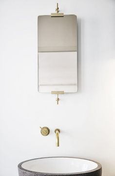 The simplicity a #bathroom vanity can bring a place is great! We love all the bronze and earth theme this place has! www.remodelworks.com