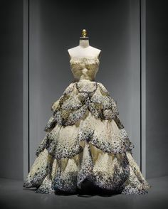 "House of Dior (French, founded 1947), Christian Dior (French, 1905–1957). ""Junon"" Dress, autumn/winter 1949–50, Haute Couture. Machine–sewn, hand–finished pale green silk faille and taffeta foundation, hand–sewn pale blue silk tulle embroidered with opalescent sequins, hand–applique of forty–five hand–cut pale blue silk tulle and horsehair petals, hand–embroidered with opalescent, blue, green, and orange gelatin sequins. Photo © Nicholas Alan Cope. #ManusxMachina #CostumeInstitute"