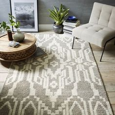 This small space globalist living room gives a light and airy feel. The intricate medallion print on our Signet Wool Rug is the result of a woven knot and cut pile construction, for an allover pattern that's cushy underfoot.