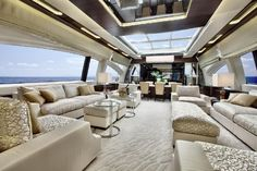 The main saloon is a bright example of luxurious Italian design on board 2016 Azimut Grande 120SL. White, cream and gold are the main ingredients of the color palette in this room.