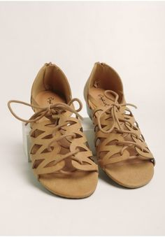 Finished with a comfortable low heel and an exposed zipper at the back, these neutral shoes pair well with casual ensembles for an adorable everyday look.
