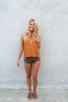 Not your average halter top. This lightweight top features twisted halter and keyhole detail. Material: 100% Rayon, Hand Wash Cold Color: Burnt Orange Model: 5'8, Wearing Size Small Mom Outfits, Short Outfits, Cute Outfits, Great Legs, Beautiful Legs, Hot Shorts, Sexy Jeans, I Dress, Asian Beauty