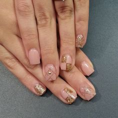 Pink nails with sparkly gold designs. Yep.