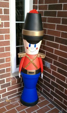 20 DIY Clay Pot Christmas Decorations That Add Charm To Your Holiday Décor Outdoor Clay Pot Nutcracker Clay Pot Projects, Clay Pot Crafts, Diy Clay, Holiday Crafts, Shell Crafts, Diy Crafts, Diy Projects, Clay Flower Pots, Flower Pot Crafts