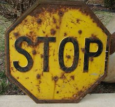Vintage stop sign... from 1915 to 1954, they were yellow... this ...