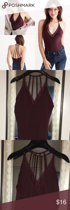 Abercrombie & Fitch Lace Trim Body Suit Bodysuit is made really well for a Abercrombie item! Really cute going out for a girls night. Wearing with jeans is really great. Great for college gals going to parties.   Fits best on US dress size 2-4 Abercrombie & Fitch Swim One Pieces