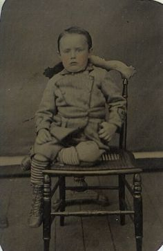 I don't think this is a post mortem photograph. The pose though is very awkward with his leg up which probably accounts for the pained look on his face.