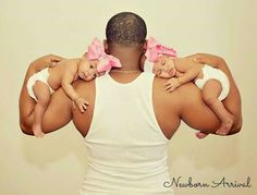 Daddy and twin daughters