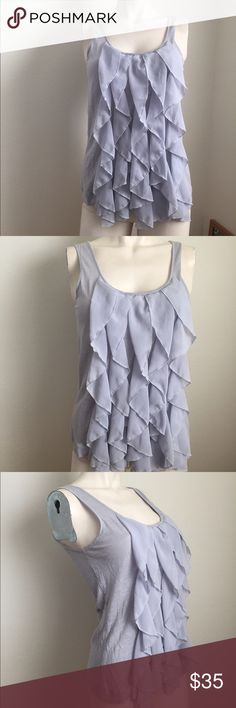 Anthropologie ruffle tank Gorgeous tank by Deletta from Anthropologie. Cascading ruffles along the front, button closure on back. Small hole under armpit from tag. Anthropologie Tops