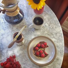 Summer mornings are always a treat with a cup of coffee served alongside a bagel with raspberries and your favorite organic hazelnut spread  Photo credit: Gabe Amaya