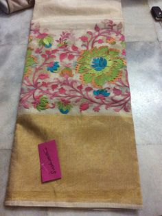 Beautiful white saree with bright contrast embroideries and gold border. Banarasi Sarees, Silk Sarees, Saris, Hand Embroidery, Machine Embroidery, Embroidery Designs, Indian Dresses, Indian Outfits, Cutwork Saree
