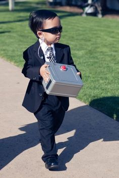 This is a hilarious ring bearer idea. More weddings need to have fun like this. Laughter produces more fond memories than safe and typical formal/classical weddings. the boys would look adorable like this