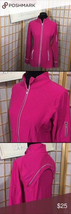 Athletic jacket Pristine condition from smoke free home. Nylon/spandex zip up pocketed, back vented, thumb hole/turn over mitten type cuffs. Stripe gives off small reflection. Nice length. Top of shoulder to bottom hem measures approximately 25 inches. Very comfortable kirkland Jackets & Coats