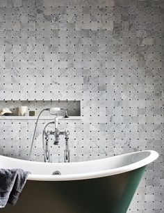 'Carrara' Marble Honed Basket Weave Mosaics create a classic and intricate wall covering in this bathroom | Mandarin Stone