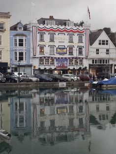 The Royal Castle Hotel, shimmering in the boat float reflections.