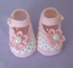 Hand knitted designer baby booties and hats. Available to order at https://www.facebook.com/just2cuteknits?ref=hl