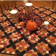 "This fall I'm decorating our table with my half scale version of Buried Treasure. It's from the 2015 ""Go Four It"" quilt along with American Patchwork and Quilting magazine. The blocks finish at Fall Quilts, Scrappy Quilts, Mini Quilts, Halloween Quilt Patterns, Halloween Quilts, Halloween Sewing, Halloween Fabric, Halloween Fun, Fall Sewing Projects"