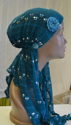 Hayaa Clothing - TEAL Sparkle Stretchy Turban Hijab Chemo Hat, $9.95 Too bad they are sold out!(http://www.hayaaclothing.com/teal-sparkle-stretchy-turban-hijab-chemo-hat/)
