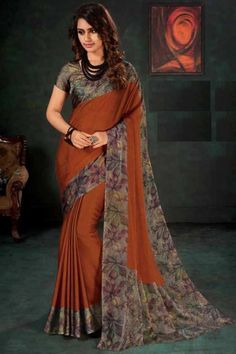 Rust Orange chiffon saree with warm grey satin blouse. Embellished with floral print embroidery. Saree with Round Neck, Short Sleeve. It comes with unstitched blouse. Raw Silk Saree, Chiffon Saree, Silk Sarees, Sabyasachi Sarees, Bollywood Saree, Maroon Saree, Orange Blouse, Blouse Online, Sarees Online
