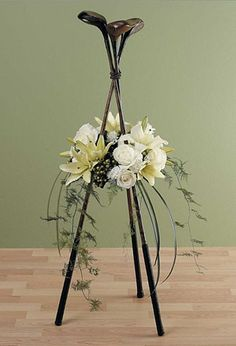 Memorial Service Ideas for the 13 Most Popular Hobbies: se golf clubs to create a gorgeous funeral flower display