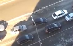 Watch this Russian freeway sinkhole open in real time.