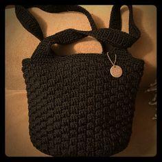 Black Sak Two strap, bucket style purse, inside pockets, snap closure. The Sak Bags