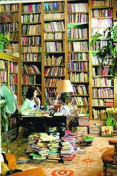 A lot of books and a writing desk. Reminds me of someone I know...trust me, that person would be very content in that environment.